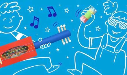 Piirretyt lapset soittavat kotitekoisia soittimia, jotka on valmistettu värillisistä kartonkiputkista