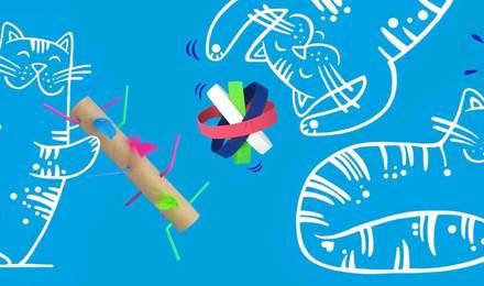 Sinisellä pohjalla olevat piirretyt kissat leikkivät kotitekoisilla kissanleluilla, jotka on valmistettu värillisestä pahvista