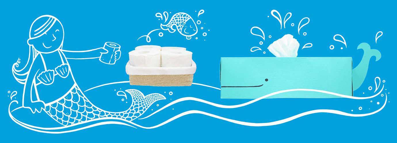 WC-paperirullat ja kotitekoinen, sinivalaan muotoinen vessapaperisäiliö, jonka päällä on piirretty merenneito